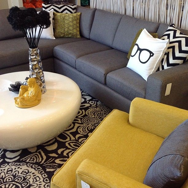 I LOVE the mustard yellow chair... would look so awesome with my brown couch from urban barn