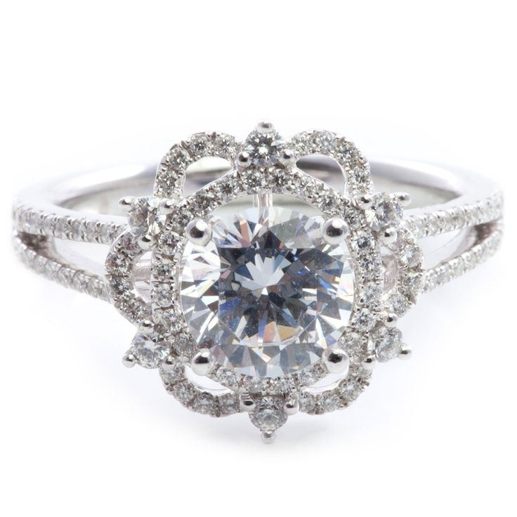 Vintage inspired 18K white gold engagment ring containing 98 round brilliant cut diamond accents