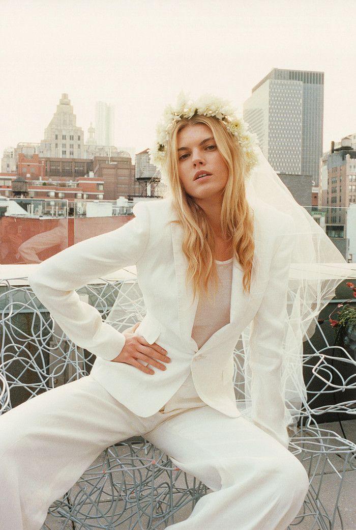 Bride in suit + floral wreath