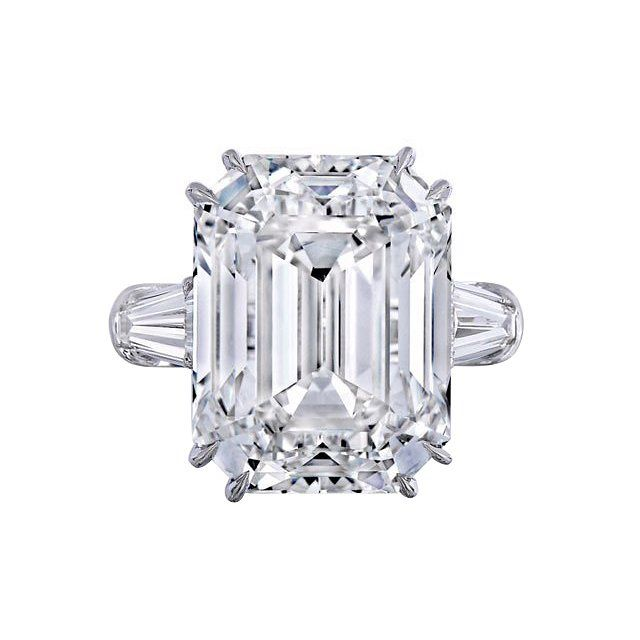 """""""Mariah Carey is officially engaged to her boyfriend, James Packer, the Australian billionaire businessman. He popped the question last night with a colossal 35-carat diamond and platinum engagement ring, seen here. Yes, you read that correctly: 35 carats—just about the same size as both Kim Kardashian West's and Beyoncé's engagement rings COMBINED. It's even a couple of points UP from Liz Taylor's famously spectacular 33 carats, courtesy of Richard Burton."""""""