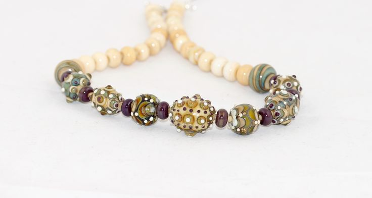 Ivory and silver glass beads as a necklace