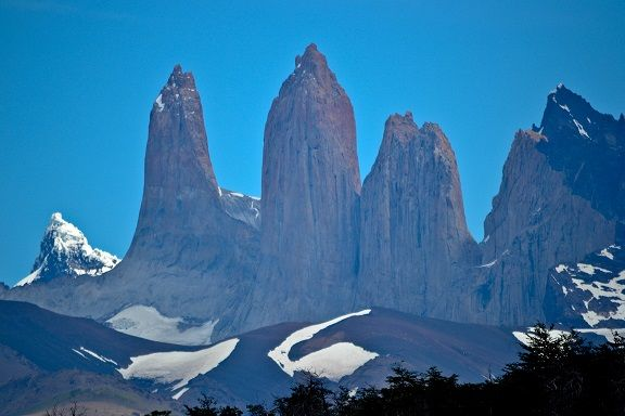 """PATAGONIA, CHILE - The three """"Towers of Pain"""" for which Torres del Paine National Park is named. Part of the Cerro Paine Grande mountain range, these granite monoliths were shaped by the forces of glacial ice."""