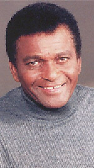 Charley Frank Pride (born March 18, 1938) is an American country music singer, musician/guitarist, recording artist, performer, and business owner. His greatest musical success came in the early- to mid-1970s when he became the best-selling performer for RCA Records since Elvis Presley. In total, he has garnered 39 No. 1 hits on the Billboard Hot Country Songs charts.