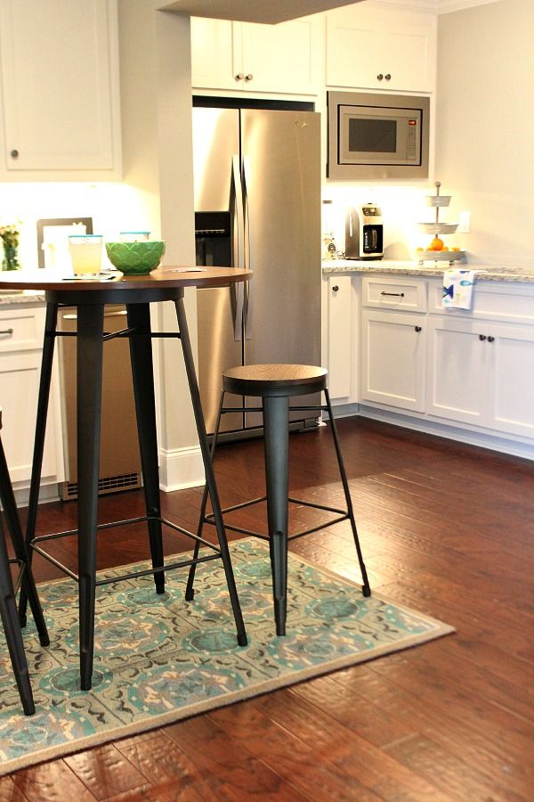 Pub table made from metal and wood for the basement from BHG Walmart.  Tips on decorating a kitchen in the basement! Light and bright for a basement.