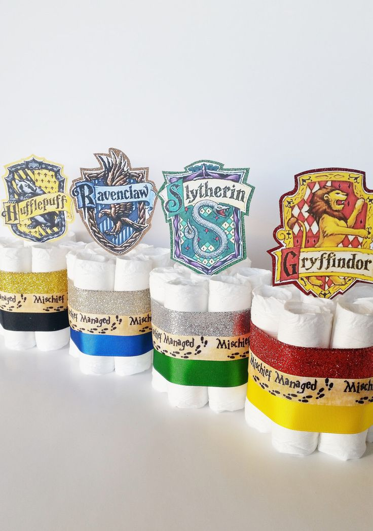 Harry Potter Baby Shower Diaper Cake Centerpieces,  Harry Potter Diaper Cakes, Welcome Muggle Shower Decor, Wizard Gryffindor Party Decor by LilLoveBugsCreations on Etsy https://www.etsy.com/listing/487982932/harry-potter-baby-shower-diaper-cake