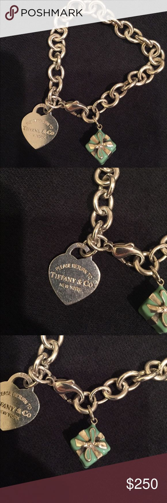 Tiffany charm bracelet Great condition. Comes with pouch and box. Tiffany & Co. Jewelry Bracelets