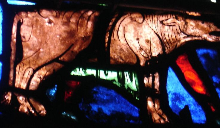 Stained glass cow at Bourges cathedral.