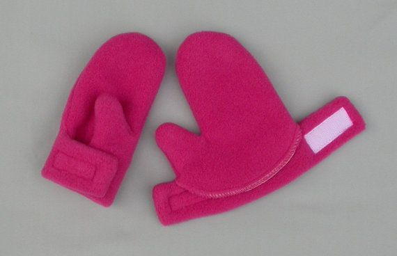 These wrap mittens for baby are so easy to slip on. They are flat when you put them on your little one. Then you wrap the wrist which is held by