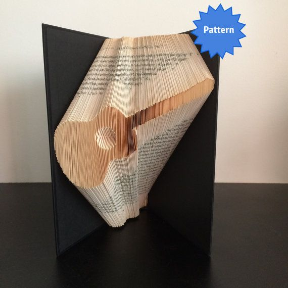 This listing is for a book folding pattern which will enable you to create your own finished book. This pattern: Guitar – 168 folds (336