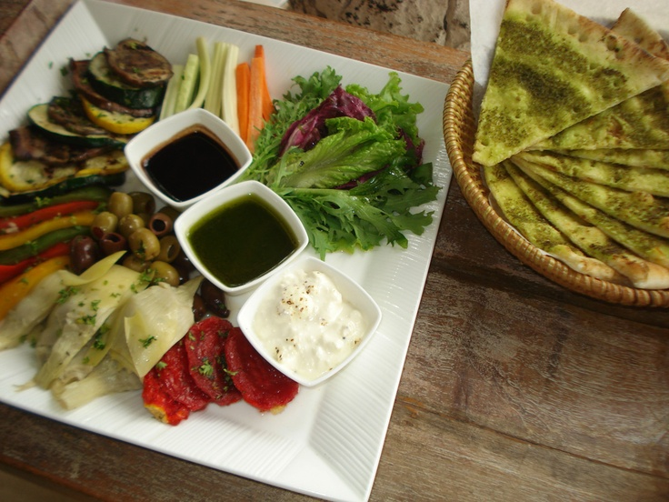 Mezze Platters Tuscany - artichoke, sundried tomatoes, marinated green olives, vegetable stick, pesto dip, baked ricotta, bianca bread, grilled zucchini and eggplant #bali #bar #restaurant #food #lunch #dinner #kuta #tuban #indonesia