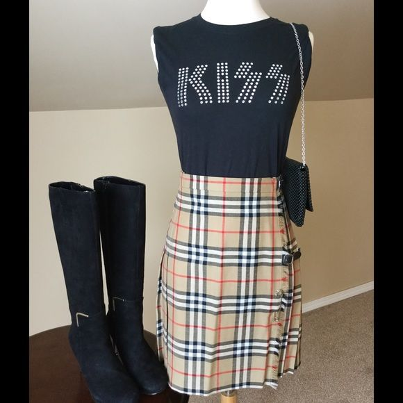 """Authentic Burberry skirt Amazing authentic Burberry skirt!!  Pleated kilt design. Measures 19"""" long. Only worn a few times and like new.  It can be dressed up or down and is timeless. Burberry Skirts"""