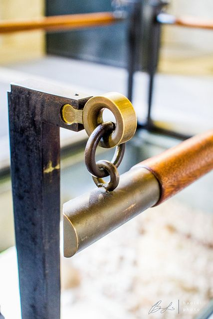 Scarpa Details. Brass. Wrought iron. Leather. Handrail. Museum barrier. Craft. Key puzzle piece connection.
