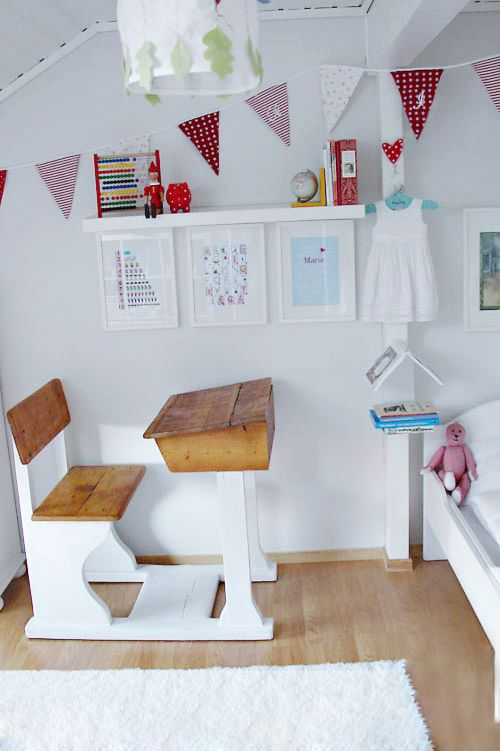 I am mad for old school desks at the moment and I love the fresh look achieved here with a lick of white paint.
