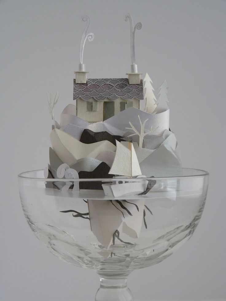 The incredible art of Helen Musselwhite ... tiny little houses of all types artfully constructed in little glasses or under little glass domes.  helenmusselwhite.com/page12.htm