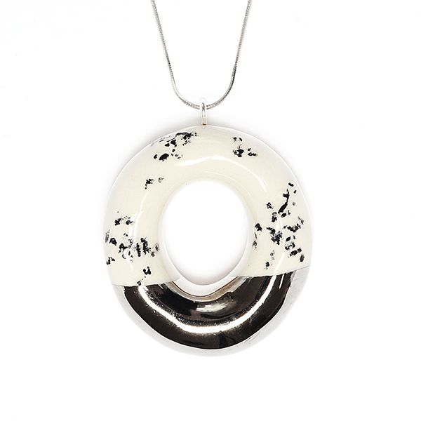This sweet doughnut pendant looks like a real dessert, but is handcrafted from clay using high-quality materials and fired up to three times. Its half or corner is dipped into ceramic silver alloy. #jewelry #pendant #doughnut #dessert #chocolate #accessory #fashion #handmade  Find it at http://www.mokosh.dk/our-talents/tadam/