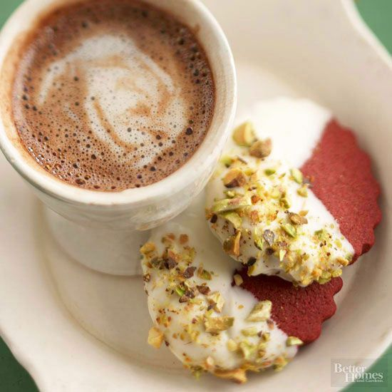 Crispy red velvet shortbread cookies have the cocoa-loaded goodness of a red velvet cake with less prep time and fewer ingredients. Chopped pistachios sprinkled on the white chocolate frosting add a colorful flourish./