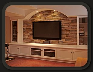 I like the idea of built-ins of some sort that could go under or frame the TV