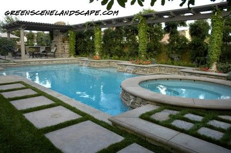 Swimming pool with raised spa and adjacent outdoor kitchen . . . The Green Scene