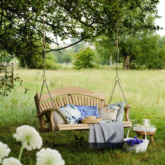 Garden lounging area This dreamy swing seat offers a perfect place to relax and enjoy the world around you. Blue and white cushions and textiles add extra comfort and style. Swing seat Sitting Spiritually Blanket The Atlantic Blanket Co Read more at http://www.housetohome.co.uk/garden/picture/garden-lounging-area#epWpYwlOFDpbkd1G.99