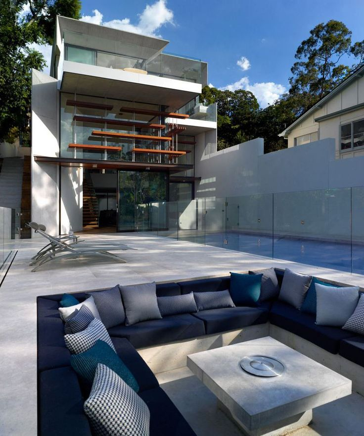 Contemporary Family Home With Large Deck, Sunken Conversation Pit And  Waterfall Edge Swimming Pool