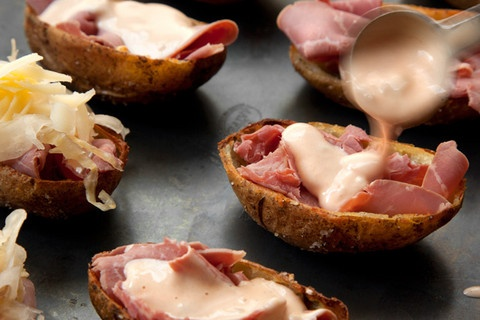 Reuben Potato Skins. Happily loaded with corned beef, Thousand Island dressing, and sauerkaut.