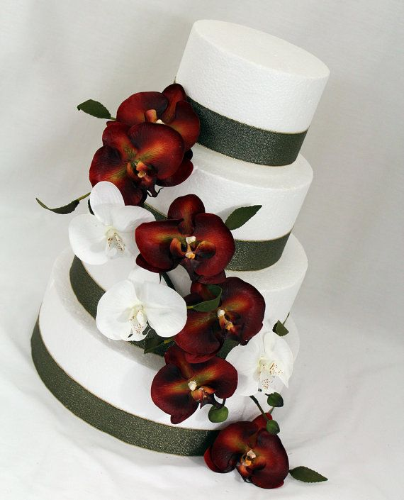 Again, not my color scheme, but I like the simplicity of the ribbon with cascading orchids