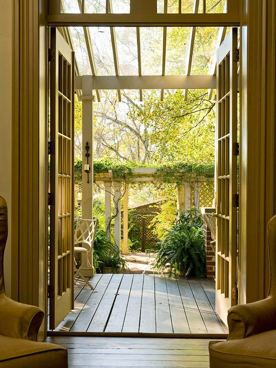 Extend the Indoors -A pergola doesn't need to be big and grand to be effective; it just needs to be used the right way. This simple pergola, outside a set of French doors, makes the transition from indoors to out in a stylish way