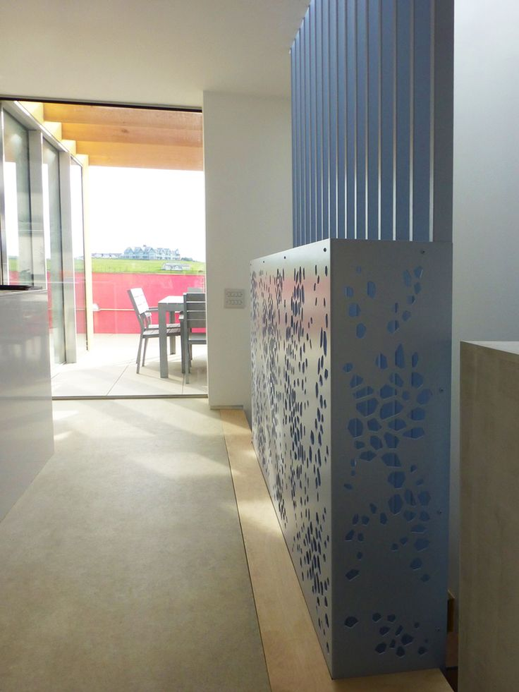 Laser cut screens - Coastal Homes, Cornwall -  Stairwell balustrade, design by Miles and Lincoln. www.milesandlincoln.com