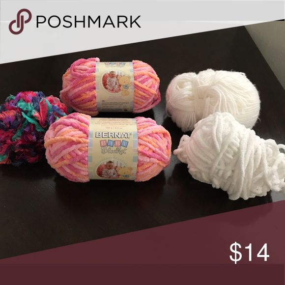Bernat &Other JoANne Yarn Found some yarn in my closet. No longer needed. 2 unopened Bernat baby blanket yarns. Used white yarn rolls, one multicolored feathered string. all from Joanne. Good steal for someone who is a crafter. Smoke & Pet free home. bernat Accessories