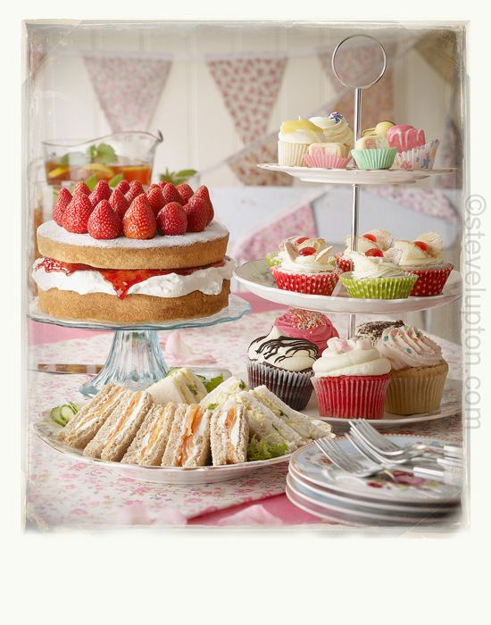 lovely tea party photo - includes salmon & cream cheese sandwiches, egg & cress sandwiches, victoria sponge cake, fancy cupcakes and iced tea!