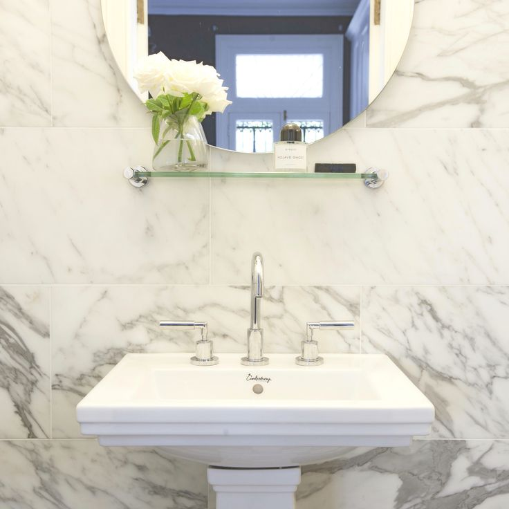 Black and white marble bathroom. Terrace house renovation. Design by Sarah Blacker Architect. Photo Anneke Hill.