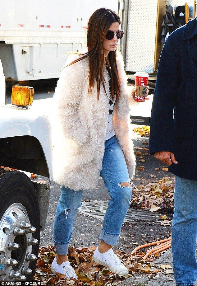 Nothing fancy:She wore her fuzzy coat over a white printed tee, and looked quite laid-back in some loose-fitting, ripped bluejeans which she cuffed at the ankle