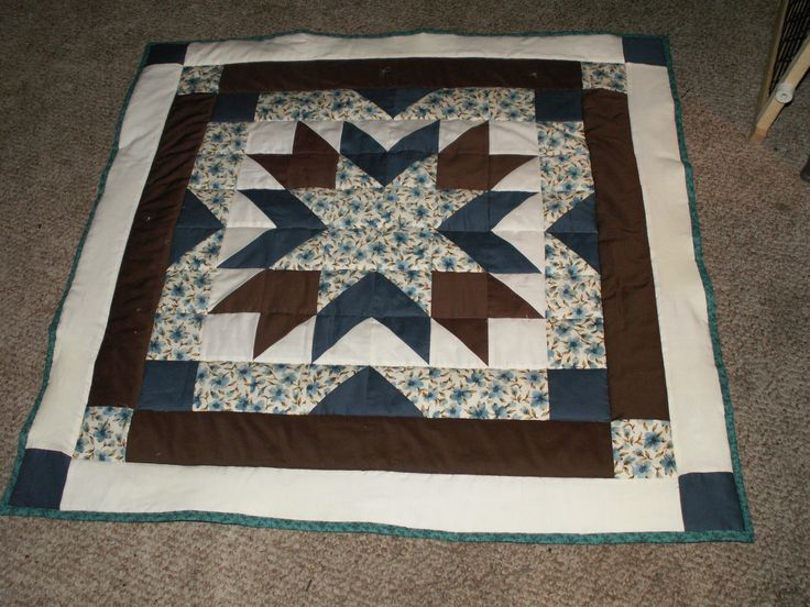 Dark Teal Brown Cream And A White Printed Fabric Are