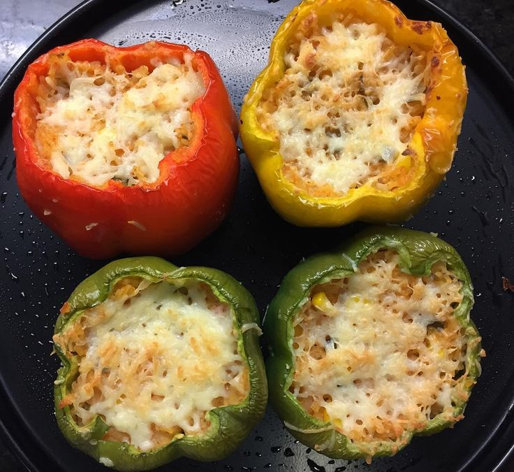 Homemade Stuffed bell peppers with cheesy rice Recipe:  Remove the top of the capsicums and then remove the seeds to make them hollow. Rub a little oil and salt inside and outside the capsicum and set aside for about ten minutes. Heat the 2 tbsp oil in a thick-bottomed pan add onions and sauté for 2 minutes. Add garlic and continue to sauté for a minute.  Add tomato puree red chilli powder and salt and cook on low heat for a minute. Add rice and two and a quarter cups of water and let it…