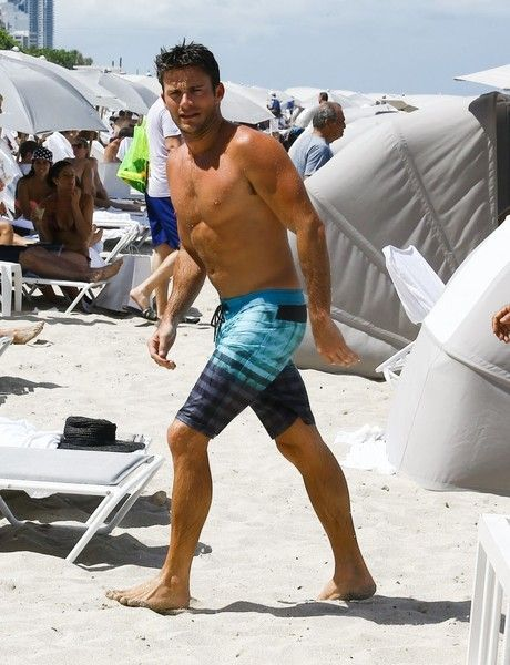 Scott Eastwood Photos - Shirtless actor Scott Eastwood enjoys a day out on the beach in Miami, Florida on July 16, 2016. The actor spent his time taking a dip in the water, and lounged out with his friends. - Scott Eastwood Enjoys A Dip In The Ocean While In Miami