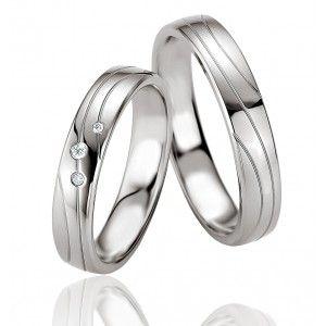 http://www.e-bijouterie.com/3148-thickbox/duo-alliances-argent-et-argent-et-diamants-tendresse.jpg