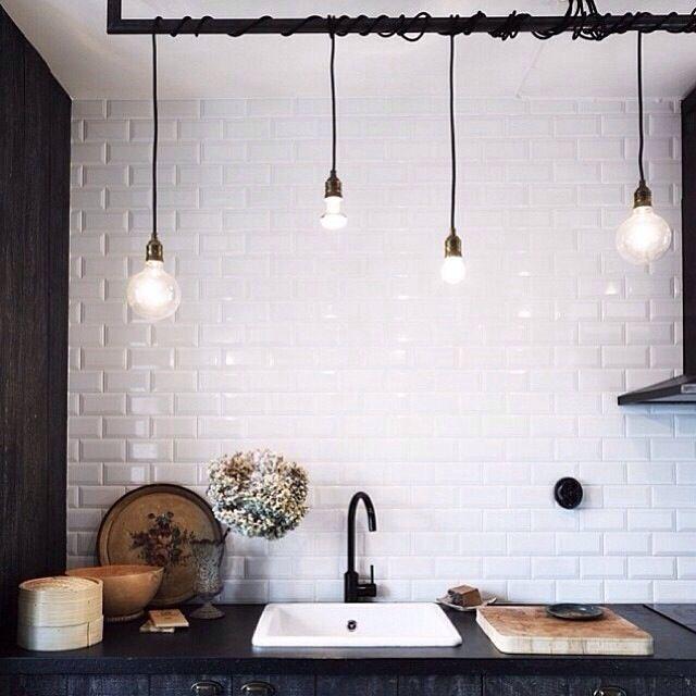 Industrial // interesting lighting // black tapwear // white subway tiles // kitchen