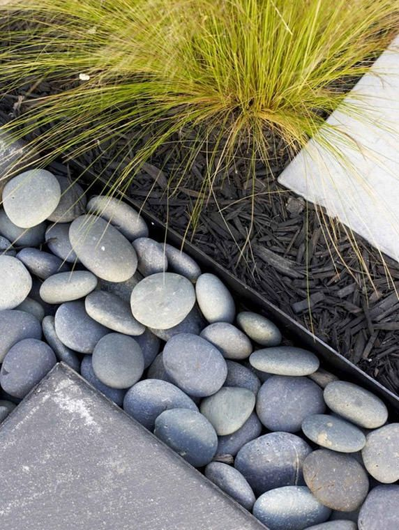 garden edging - use gutters, sink them into the ground and fill with stones. Will keep the stones weed free