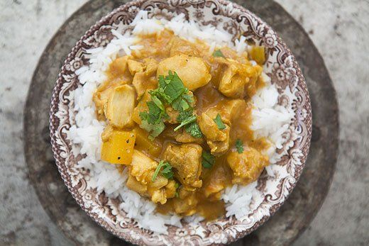 Mango Chicken Curry ~ Mango and chicken are a power combo.  This mango chicken curry recipe uses boneless, skinless breasts or thighs, mango, onion, ginger, garlic, curry, cumin, raisins, and coconut milk. ~ SimplyRecipes.com