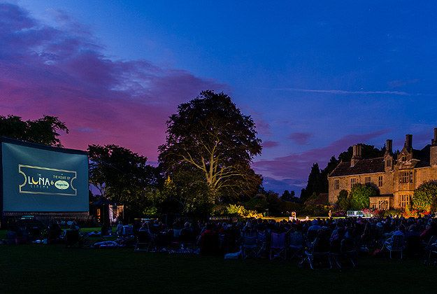 Wakehurst Place, West Sussex | Delve your hand not into a bucket of popcorn but a wicker picnic hamper, as you watch a movie in the glow of the moon, on the lawn of Wakehurst Place, West Sussex. Taking place over August Bank Holiday weekend, there'll be screenings of both Dirty Dancing (August 24) and blockbuster Gravity (August 25), with the price of admission ranging from £10.50 to £24.50. No seating is provided, so be sure to bring along a comfy quilt 22 Spectacular Open-Air Cinemas In…
