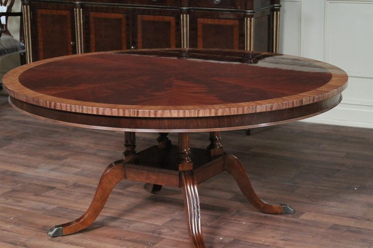 Flame mahogany 60″ round American made dining room table. Model LH HC 60