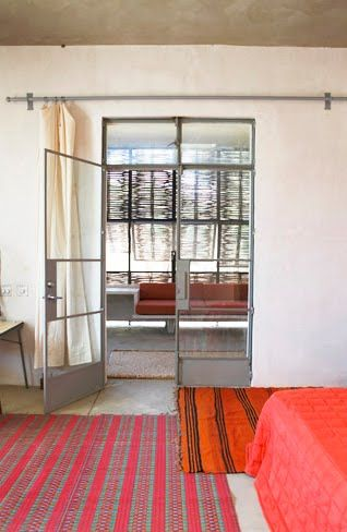 striped carpet, glass doors, white walls