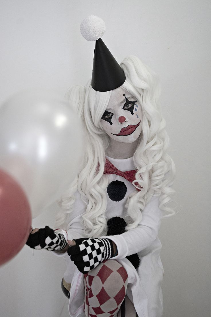 This is an easy and unique sad clown costume that started out with a basic cotton shirt dress for my daughter since she dislikes regular textured costumes.