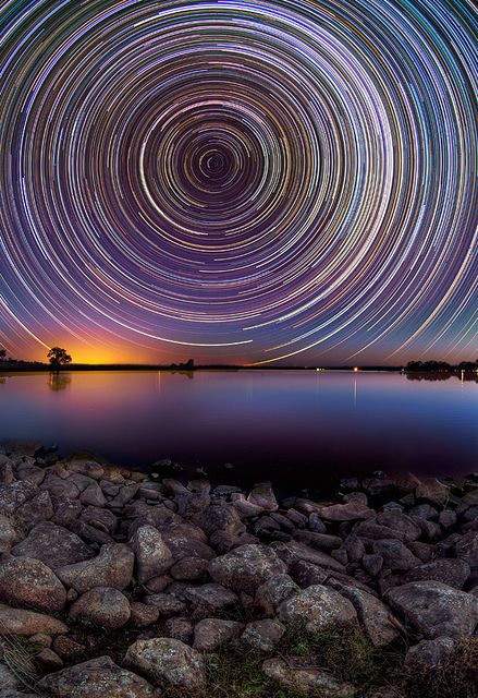 Australian photographer Lincoln Harrison captures long exposures of gorgeous star trails in the night sky above the Australian outback