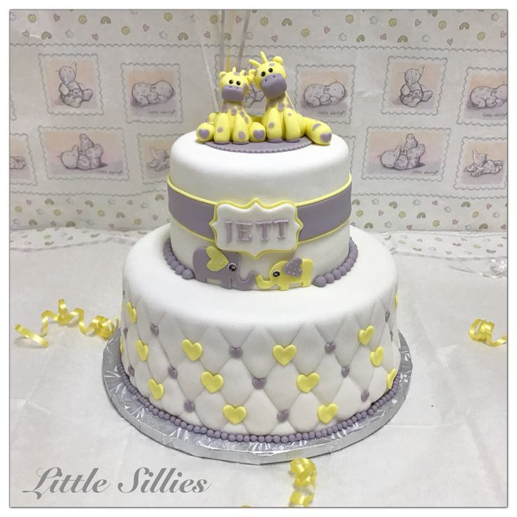 A Yellow And Grey Giraffe And Elephant Themed Baby Shower Cake.