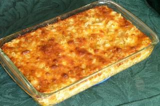 Yummiest Ever Baked Mac and Cheese from Food.com:   								A friend brought a big pan of this to a potluck and I HAD to have the recipe to make for my family.  It is so yummy and creamy that it's hard to stop eating.  We like it as a main dish with a salad, but you could serve it as a scrumptious side dish.  These are directions for the full batch which will serve a crowd.  It halves easily.