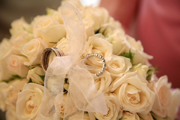 A detail of the flower cushion with the wedding rings
