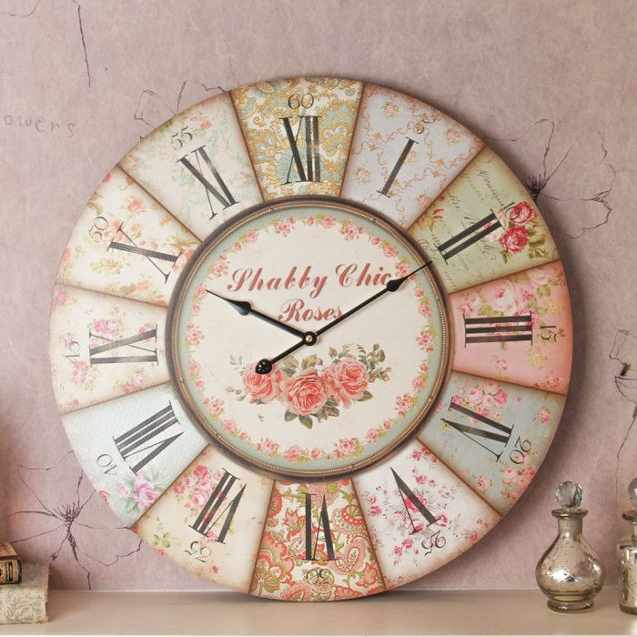 A beautiful addition to any shabby chic home. This wall clock is made from wood and finished with a vintage patchwork effect to the numbers. It displays clear Roman numerals along with numbered minute markers. With long metal hands that clearly display the time. This would make the ideal gift for someone who loves vintage 50;s style and would complement the home that enjoys pastel colours. Simply hang from a nail or a screw in the wall and power with one AA battery (not supplied)