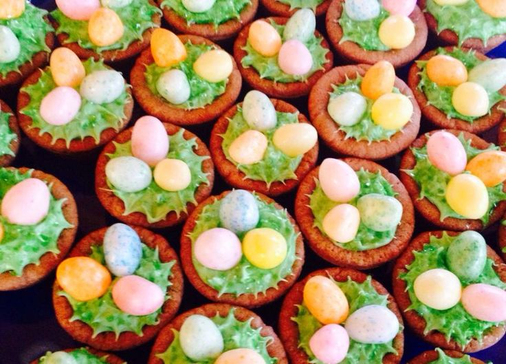 Bake sugar cookies in mini muffin tins, pressing an indent into the center of each dough ball. Then fill with green frosting and top with jelly beans for adorable birds' nests :)