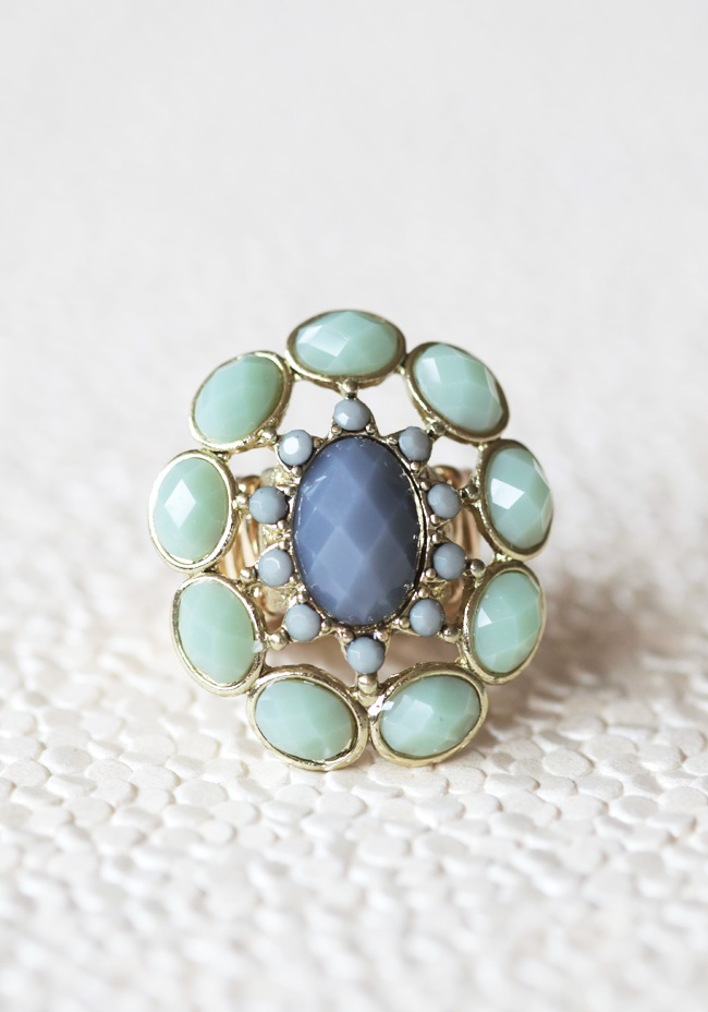 """Daydreaming Beauty Ring $12.99 at shopruche.com. This gold colored ring features gray and sage green pendants for a statement design. Elasticized band.Elasticized, starting at size 5.5, Pendant: 1.5"""" diameter"""